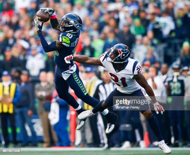 Wide receiver Paul Richardson of the Seattle Seahawks makes a 48 yard catch against safety Marcus Gilchrist of the Houston Texans during the fourth...