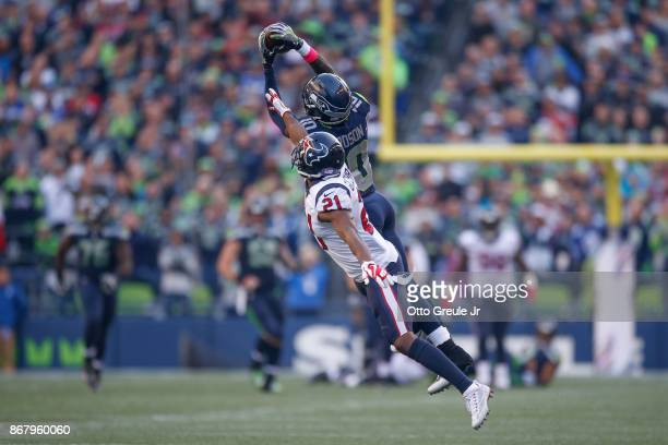 Wide receiver Paul Richardson of the Seattle Seahawks makes a catch in the fourth quarter against safety Marcus Gilchrist of the Houston Texans at...