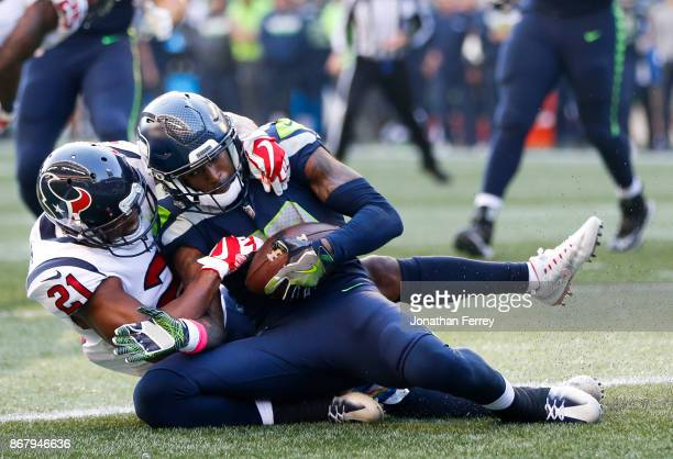 Wide receiver Paul Richardson of the Seattle Seahawks pulls in a touchdown against safety Marcus Gilchrist of the Houston Texans that is nullified...