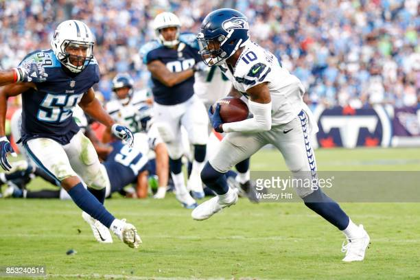 Wide Receiver Paul Richardson of the Seattle Seahawks runs the ball into the end zone to score a touchdown against the Tennessee Titans at Nissan...