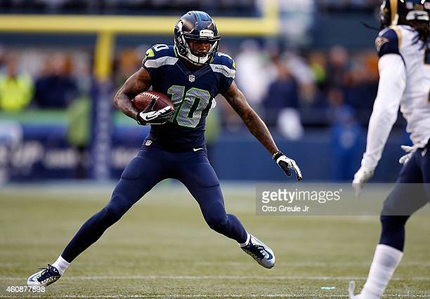 Wide receiver Paul Richardson of the Seattle Seahawks runs with a pass reception during the third quarter of the game against the St Louis Rams at...