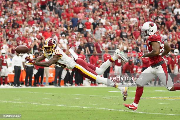 Wide receiver Paul Richardson of the Washington Redskins attempts to catch a pass during the NFL game against the Arizona Cardinals at State Farm...