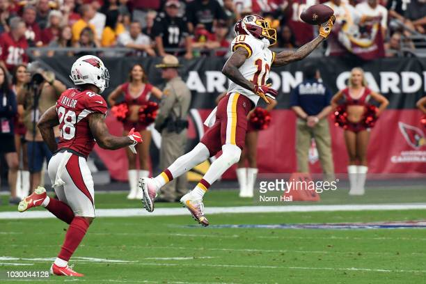 Wide receiver Paul Richardson of the Washington Redskins makes a catch over defensive back Jamar Taylor of the Arizona Cardinals during the third...
