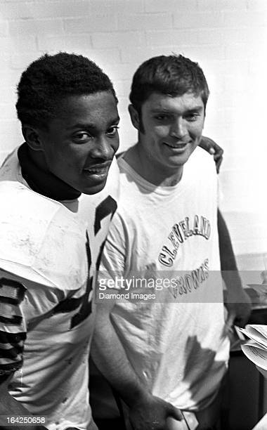 Wide receiver Paul Warfield and quarterback Bill Nelsen of the Cleveland Browns pose for a picture together after a playoff game against the Dallas...