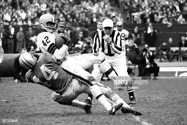 Wide Receiver Paul Warfield of the Cleveland Browns is tackled by of the Detroit Lions after catching a pass during a game on November 15 1964 at...