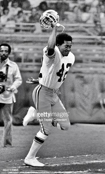 Wide receiver Paul Warfield of the Cleveland Browns runs onto the field after being introduce prior to a game against the New York Jets on September...