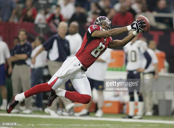 Wide receiver Peerless Price of the Atlanta Falcons dives for a catch during the game against the San Diego Chargers on October 17, 2004 at the...