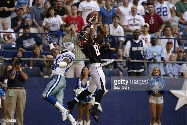 Wide receiver Peerless Price of the Atlanta Falcons pulls in a 22yard catch to set up a touchdown against the Dallas Cowboys on September 7 2003 at...