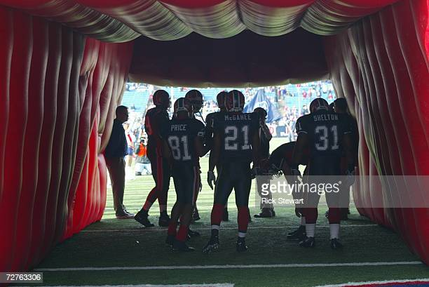 Wide receiver Peerless Price, running back Willis McGahee and fullback Daimon Shelton of the Buffalo Bills stand in the tunnel before the game...
