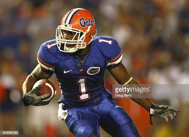 Wide receiver Percy Harvin of the Florida Gators looks for room to run against the Miami Hurricanes at Ben Hill Griffin Stadium on September 6 2008...