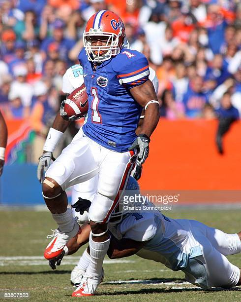 Wide receiver Percy Harvin of the Florida Gators runs for a large gain in the first quarter against the Citadel Bulldogs during the game at Ben Hill...