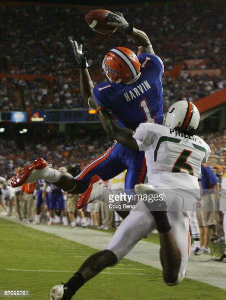 Wide receiver Percy Harvin of the Florida Gators tries to make a catch in the endzone as he is interferred with by defensive back Randy Phillips of...