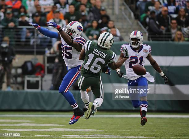 Wide Receiver Percy Harvin of the New York Jets has a long pass broken up by Safety Da'Norris Searcy of the Buffalo Bills at MetLife Stadium on...
