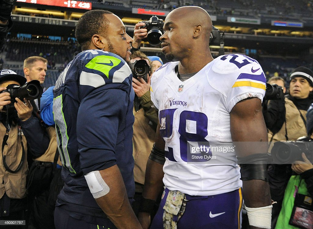 Wide receiver Percy Harvin #11 of the Seattle Seahawks and running back Adrian Peterson #28 of the Minnesota Vikings speak after the game at CenturyLink Field on November 17, 2013 in Seattle,Wa. The Seahawks won the game 41-20.