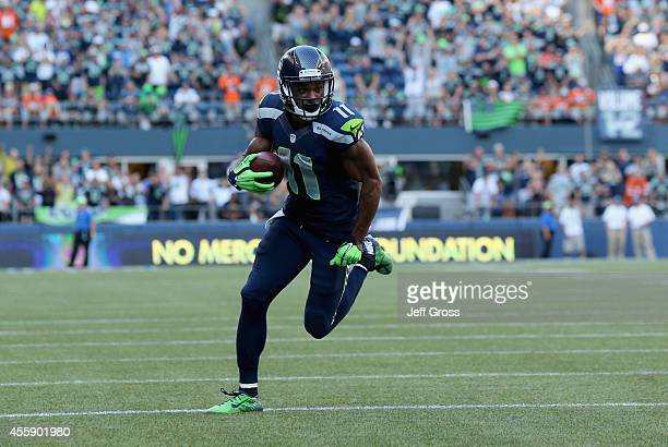 Wide receiver Percy Harvin of the Seattle Seahawks carries the ball against the Denver Broncos at CenturyLink Field on September 21 2014 in Seattle...