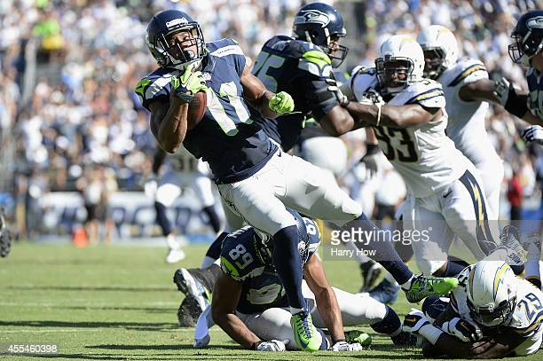 Wide receiver Percy Harvin of the Seattle Seahawks is tackled by cornerback Shareece Wright of the San Diego Chargers at Qualcomm Stadium on...