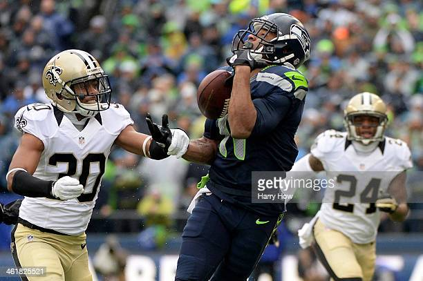 Wide receiver Percy Harvin of the Seattle Seahawks is unable to make a catch against cornerback Jeremy Lane of the Seattle Seahawks but the Saints...