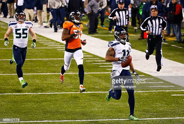 Wide receiver Percy Harvin of the Seattle Seahawks returns the second half kickoff for 87 yards during Super Bowl XLVIII at MetLife Stadium against...