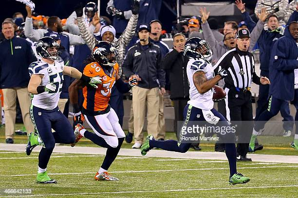 Wide receiver Percy Harvin of the Seattle Seahawks runs 87yards to score a touchdown against the Denver Broncos in the third quarter during Super...