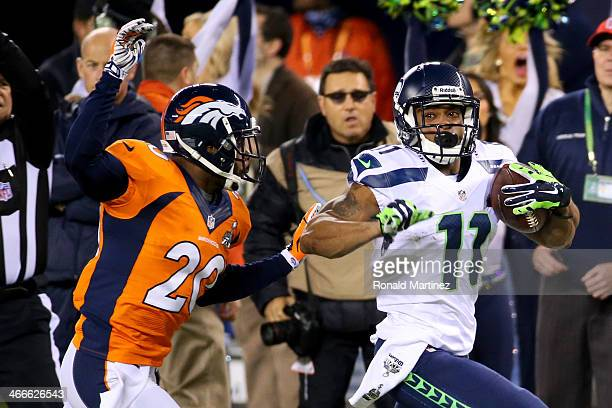 Wide receiver Percy Harvin of the Seattle Seahawks runs the ball 30yards against free safety Mike Adams of the Denver Broncos in the first quarter...