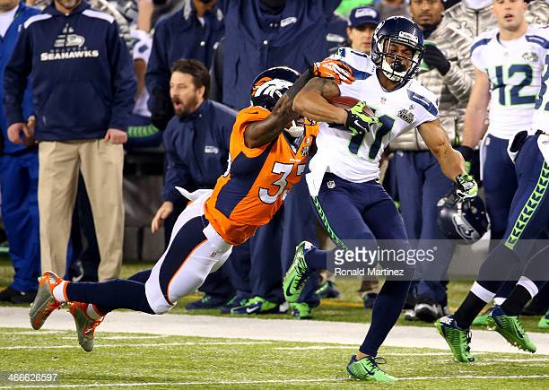 Wide receiver Percy Harvin of the Seattle Seahawks runs the ball against strong safety Duke Ihenacho of the Denver Broncos in the first quarter...