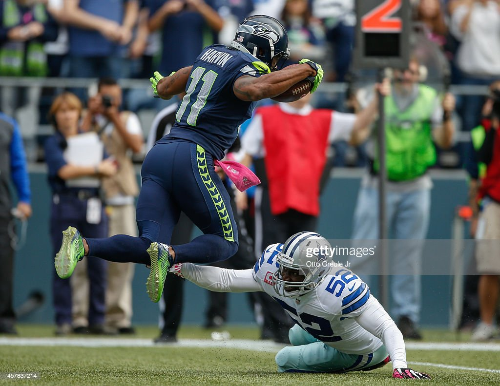 Wide receiver Percy Harvin #11 of the Seattle Seahawks rushes against linebacker Justin Durant #52 of the Dallas Cowboys at CenturyLink Field on October 12, 2014 in Seattle, Washington.