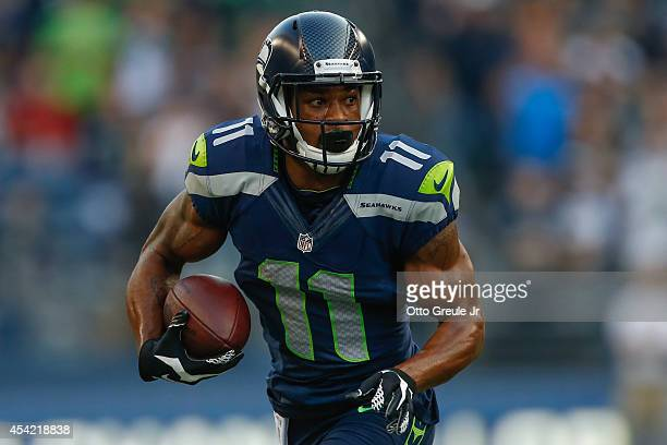 Wide receiver Percy Harvin of the Seattle Seahawks rushes against the Chicago Bears at CenturyLink Field on August 22 2014 in Seattle Washington