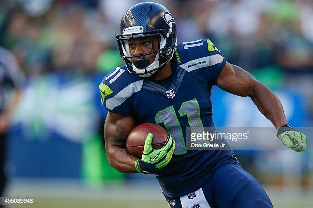 Wide receiver Percy Harvin of the Seattle Seahawks rushes against the Green Bay Packers at CenturyLink Field on September 4 2014 in Seattle Washington