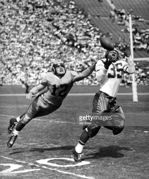 Wide receiver Pete Pihos of the Philadelphia Eagles gets past defensive back Les Horvath of the Los Angeles Rams goes up for a catch in a 2828 tie on...