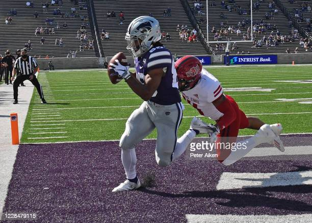 Wide receiver Phillip Brooks of the Kansas State Wildcats catches a touchdown pass against the Arkansas State Red Wolves during the first half at...