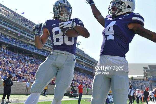 Wide receiver Phillip Brooks of the Kansas State Wildcats celebrates after catching a touchdown pass with wide receiver Malik Knowles of the Kansas...
