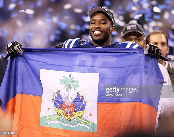 Wide receiver Pierre Garcon of the Indianapolis Colts celebrates with the Haitian flag after the Colts defeated the New York Jets 3017 in the AFC...