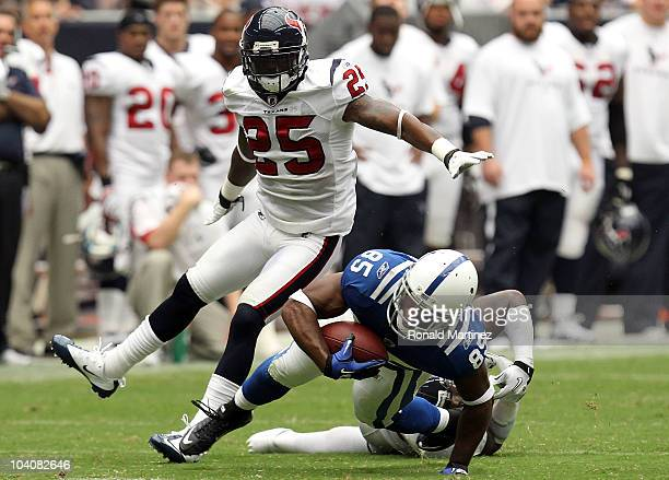 Wide receiver Pierre Garcon of the Indianapolis Colts runs the ball against Zac Diles and Kareem Jackson of the Houston Texans during the NFL season...