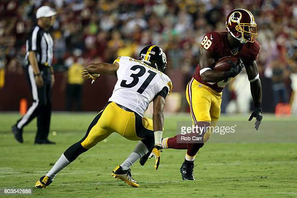 Wide receiver Pierre Garcon of the Washington Redskins carries the ball against defensive back Ross Cockrell of the Pittsburgh Steelers in the first...