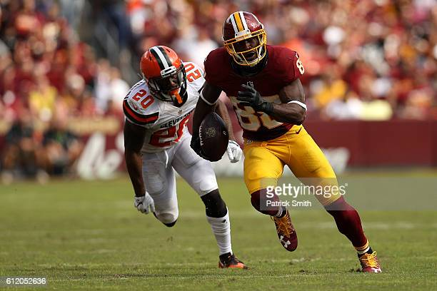 Wide receiver Pierre Garcon of the Washington Redskins carries the ball past cornerback Briean BoddyCalhoun of the Cleveland Browns in the fourth...