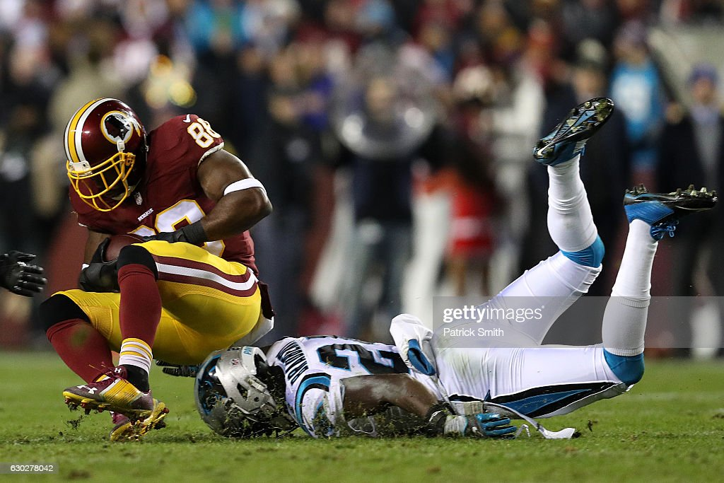 Wide receiver Pierre Garcon #88 of the Washington Redskins carries the ball against cornerback James Bradberry #24 of the Carolina Panthers in the second quarter at FedExField on December 19, 2016 in Landover, Maryland.