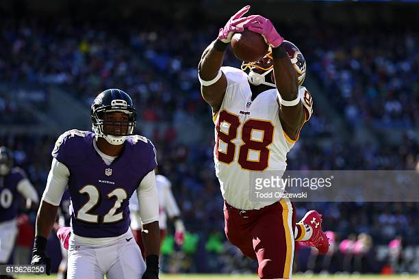 Wide receiver Pierre Garcon of the Washington Redskins catches a touchdown in the second half against the Baltimore Ravens at MT Bank Stadium on...