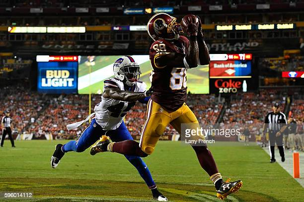 Wide receiver Pierre Garcon of the Washington Redskins cores a touchdown during the second quarter during the game between the Washington Redskins...