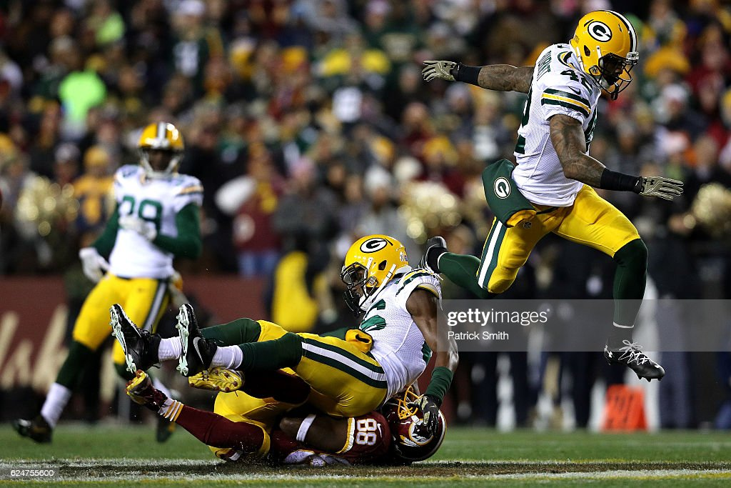 Wide receiver Pierre Garcon #88 of the Washington Redskins is tackled by cornerback LaDarius Gunter #36 and strong safety Morgan Burnett #42 of the Green Bay Packers in the first quarter at FedExField on November 20, 2016 in Landover, Maryland.