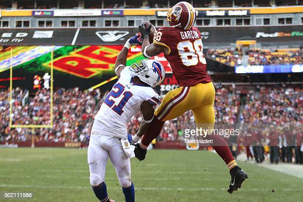 Wide receiver Pierre Garcon of the Washington Redskins scores a fourth quarter touchdown past strong safety Leodis McKelvin of the Buffalo Bills at...