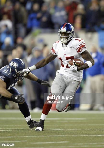 Wide receiver Plaxico Burress of the New York Giants attempts to elude linebacker Lofa Tatupu of the Seattle Seahawks during the game at Qwest Field...
