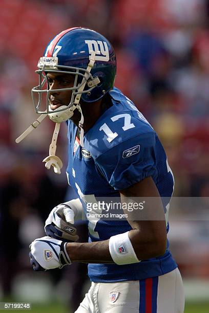 Wide receiver Plaxico Burress of the New York Giants moves to the music during drills prior to a game on December 24 2005 against the Washington...