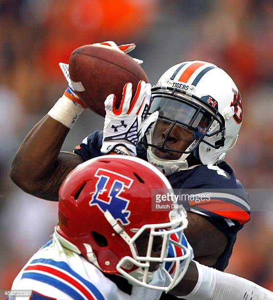 Wide receiver Quan Bray of the Auburn Tigers catches a pass for a touchdown over the top of defensive back Xavier Woods of the Louisiana Tech...