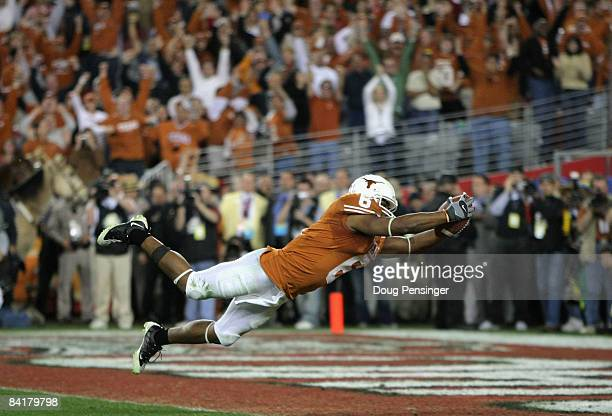 Wide receiver Quan Cosby of the Texas Longhorns dives into the endzone after a 26 yard touchdown reception against the Ohio State Buckeyes during the...