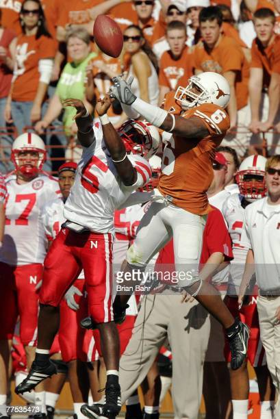 Wide receiver Quan Cosby of the Texas Longhorns jumps for the ball against cornerback Armando Murillo of the Nebraska Cornhuskers in the second...