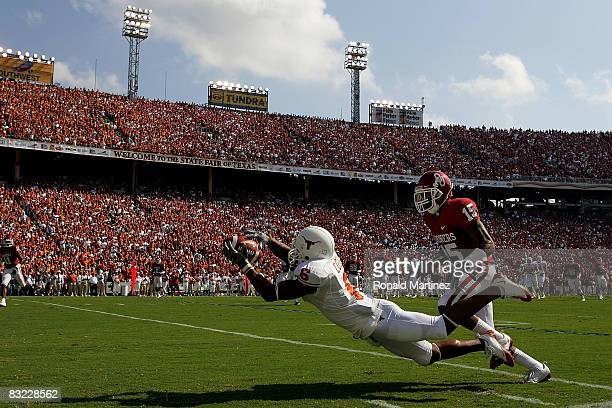 Wide receiver Quan Cosby of the Texas Longhorns makes a pass reception against Dominique Franks of the Oklahoma Sooners during the Red River Rivalry...