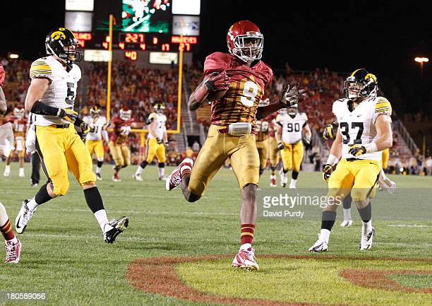 Wide receiver Quenton Bundrage of the Iowa State Cyclones drives the ball into the end zone to score in the 4th quarter of play as defensive back...