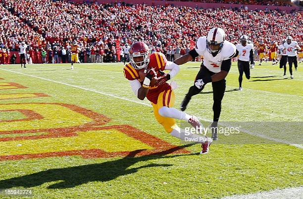 Wide receiver Quenton Bundrage of the Iowa State Cyclones pulls in a pass in the end zone for a touchdown as cornerback Justin Gilbert of the...