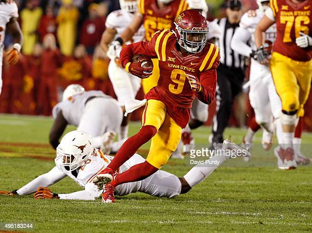 Wide receiver Quenton Bundrage of the Iowa State Cyclones rushes for yards past cornerback Antwuan Davis of the Texas Longhorns in the first half of...