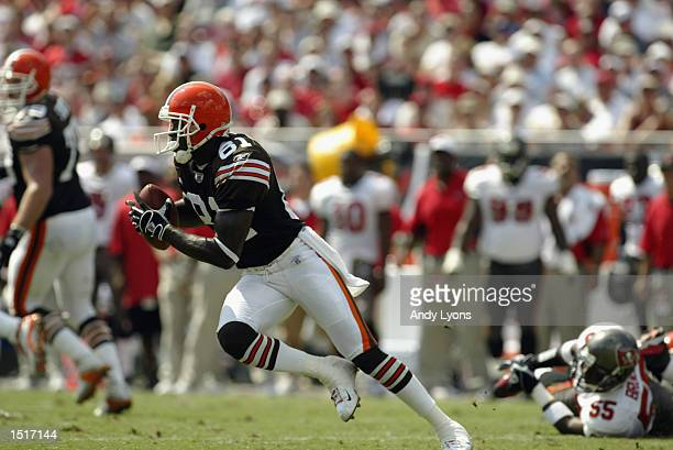 Wide receiver Quincy Morgan of the Cleveland Browns runs with the ball during the NFL game against the Tampa Bay Buccaneers on October 13 2002 at...
